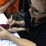 Carrie Fisher signing my OOAK Princess Leia doll!